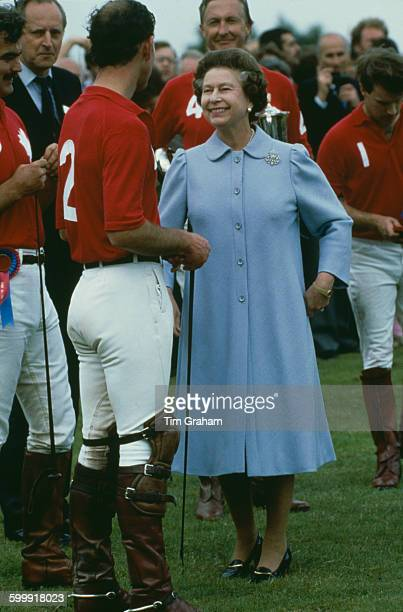 Queen Elizabeth II with Prince Charles at a prizegiving ceremony at Guards Polo Club Smith's Lawn in the grounds of Windsor Castle Berkshire 14th...