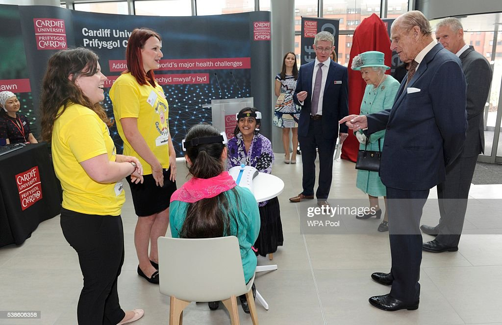 Queen Elizabeth II (R) with Prince Philip, Duke of Edinburgh (R) attend the opening of the Cardiff University Brain Research Imaging Centre on June 7, 2016 in Cardiff, Wales.