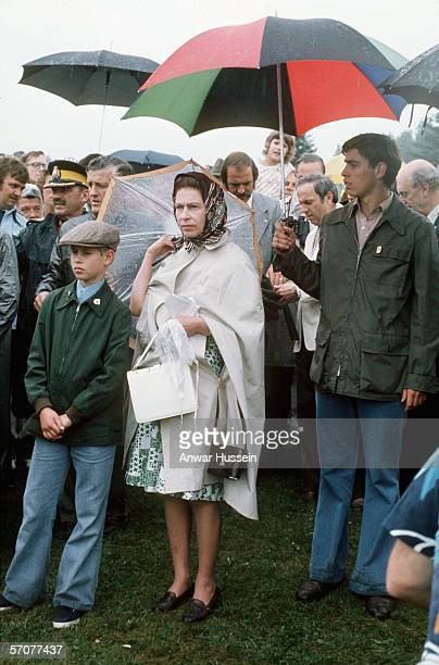 Queen Elizabeth II with Princes Andrew and Edward watch Princess Anne compete in the Equestrian event at the 1976 Summer Olympics on July 23 1976 in...