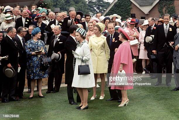 Queen Elizabeth II with Princess Anne and the Queen Mother in the unsaddling enclosure at Ascot 17th June 1970 They are awaiting the arrival of the...