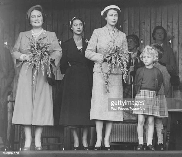 Queen Elizabeth II with Queen Elizabeth the Queen Mother Princess Margaret and children Princess Anne and Prince Charles watching the Braemar...