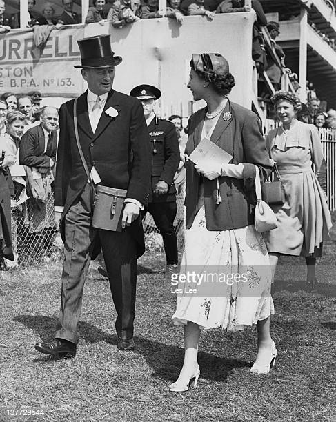 Queen Elizabeth II with racehorse owner Sir Humphrey de Trafford on Ladies' Day at Epsom Downs Racecourse Surrey 4th June 1954