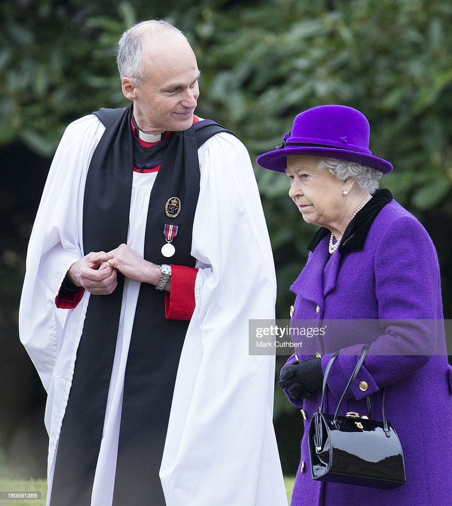 Queen Elizabeth II with Reverend Jonathan Riviere attends a service at the Church Of St Peter And St Paul in West Newton near Sandringham on February 3, 2013 near King's Lynn, England.