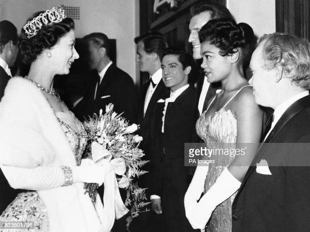 Queen Elizabeth II with singer Eartha Kitt and other performers after the Royal Variety Show at the London Coliseum Fifth from right is singer Pat...