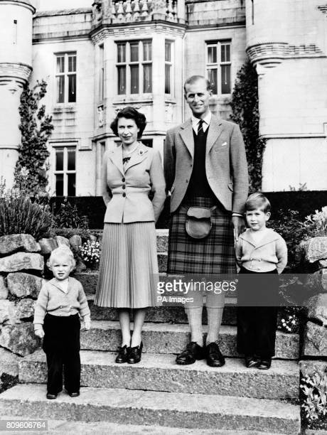 Queen Elizabeth II with the Duke of Edinburgh and their children Princess Anne left and Prince Charles at Balmoral Castle