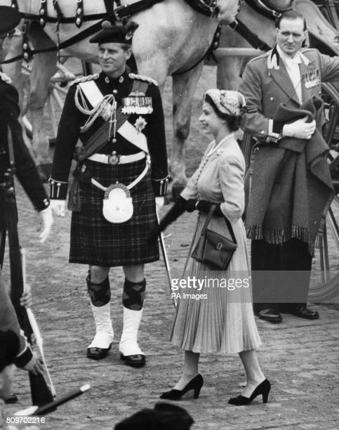 Queen Elizabeth II with the Duke of Edinburgh in the full dress kilted uniform as ColonelinChief of the Queen's Own Cameron Highlanders walking intro...
