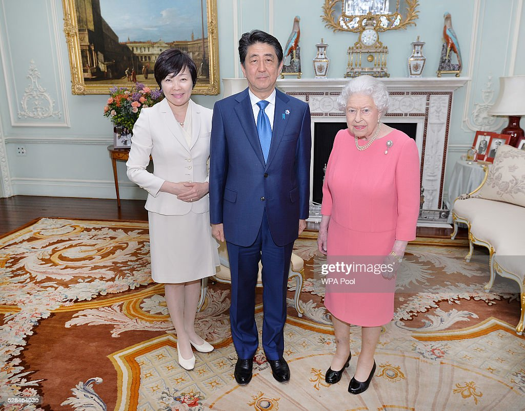 Queen Elizabeth II with the Prime Minister of Japan Shinzo Abe and wife Akie after they arrived for a private audience at Buckingham Palace on May 4, 2016 in London, United Kingdom.