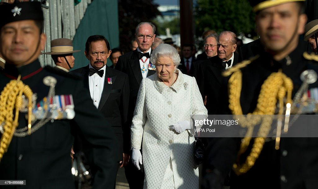 Queen Elizabeth II with the Sultan of Brunei arrive at the Gurkha 200 pageant in the grounds of the Royal Hospital Chelsea on June 9, 2015 in London, United Kigndom. The event is part of the bicentenary celebrations of Nepalese Gurkha soldiers in the British armed forces. Since first serving as part of the army in British-run India in 1815, they have built a reputation for ferocity, loyalty and razor-sharp kukri fighting knives and 26 of their members have been awarded the Victoria Cross, Britain's highest military award for bravery.