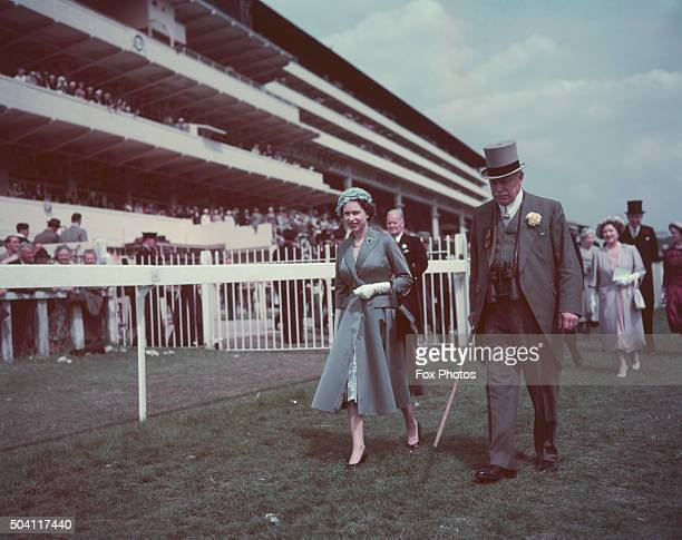 Queen Elizabeth II with with politician Harry Primrose 6th Earl of Rosebery at the Derby Epsom Downs Racecourse Surrey June 1958
