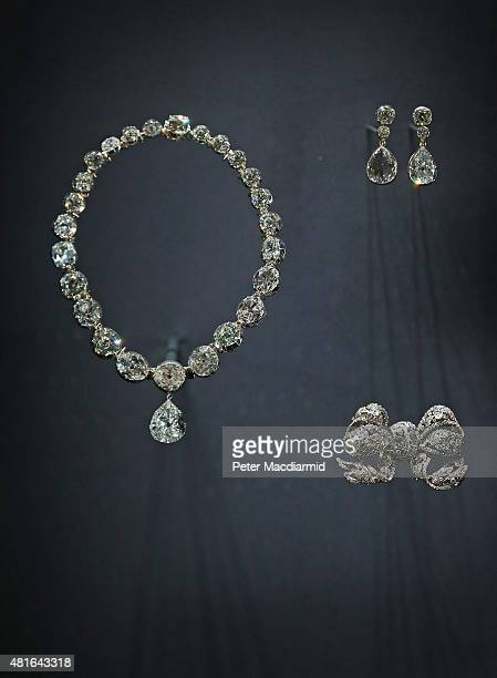 Queen Elizabeth II's Coronation Necklace and Earings are displayed with Queen Mary's Dorset Bow Broach at The Royal Welcome Summer opening at...