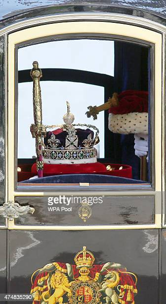 Queen Elizabeth II's Imperial State Crown is driven by carriage from Buckingham Palace to the Houses of Parliament during the State Opening of...