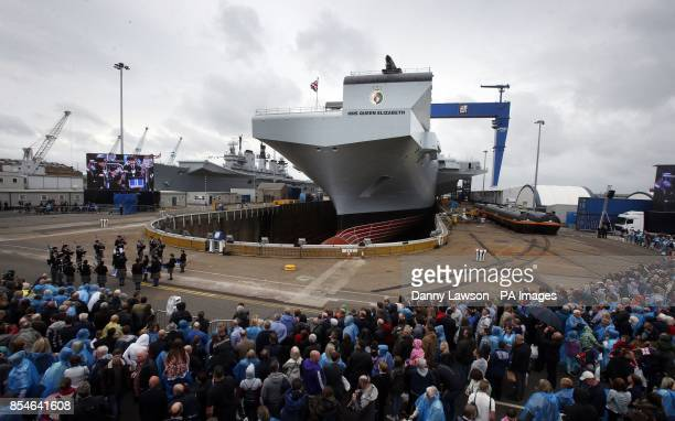 HMS Queen Elizabeth in Rosyth Dockyard Fife as the Queen will formally name the Royal Navy's biggest ever ship with whisky replacing the more...
