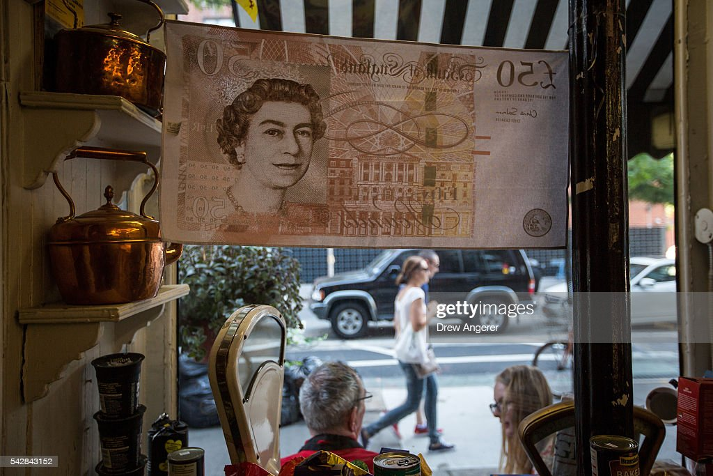 Queen Elizabeth is displayed on a flag of a 50 pound note at Myers of Keswick, a British grocery store, June 24, 2016 in New York City. British citizens voted in a referendum (also known as the Brexit) to leave the European Union which has caused uncertainty across the world.