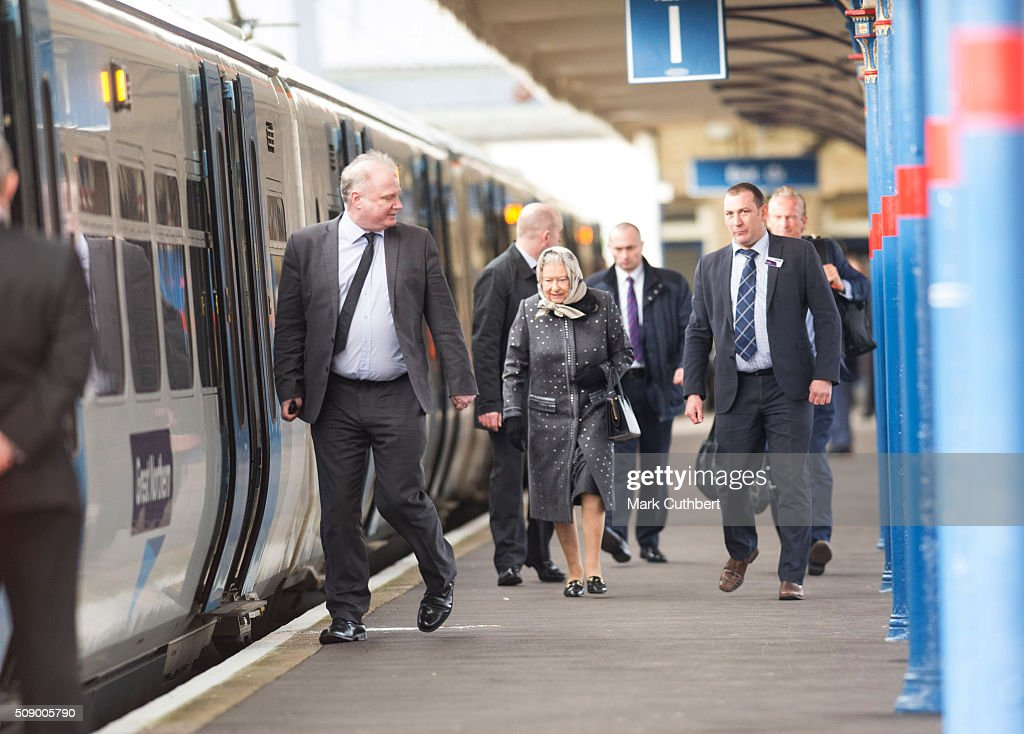 Queen Elizabeth lI boards a train back to London after her Christmas break in Sandringham at King's Lynn Station on February 8, 2016 in King's Lynn, England.