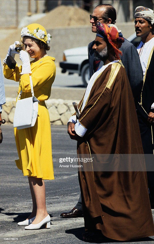 Queen Elizabeth ll, accompanied by Sultan Qaboos, takes photos with her golden Rollei 35 camera as she arrives with <a gi-track='captionPersonalityLinkClicked' href=/galleries/search?phrase=Prince+Philip&family=editorial&specificpeople=92394 ng-click='$event.stopPropagation()'>Prince Philip</a>, Duke of Edinburgh for a State Visit to Oman on February 28, 1979 in Muscat, Oman.