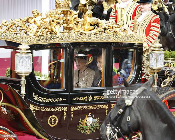 Queen Elizabeth ll and French President Nicolas Sarkozy ride in a carriage to Windsor Castle at the start of the two day State Visit on March 26 2008...