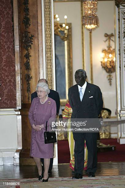 Queen Elizabeth ll and His Excellency Mr John Agyekum Kufuor the President of Ghana look at some exhibits in the Picture Gallery at Buckingham Palace...