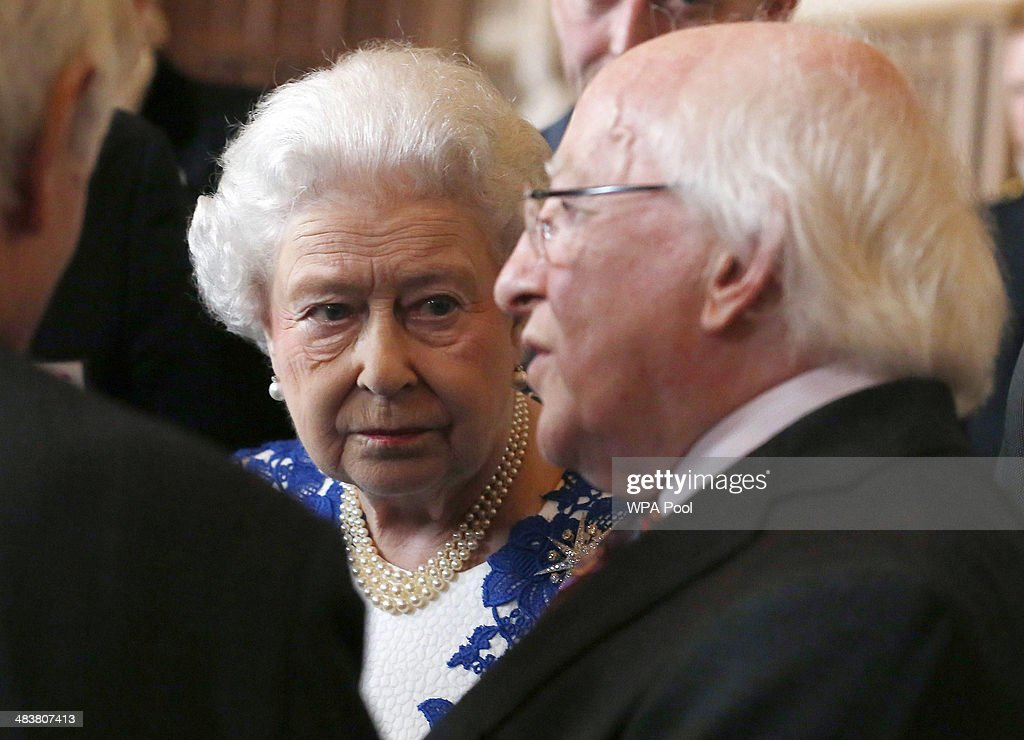 Queen Elizabeth ll and Ireland's President Michael D Higgins attend a Northern Ireland-themed reception at Windsor Castle on April 10, 2014 in Windsor, United Kingdom. The event was organised as part of Irish President Michael D Higgins' four-day state visit. The visit comes three years after Queen Elizabeth II made a groundbreaking trip to the republic, which helped to heal deep-rooted unease and put British-Irish relations on a new footing.