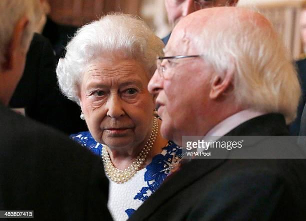 Queen Elizabeth ll and Ireland's President Michael D Higgins attend a Northern Irelandthemed reception at Windsor Castle on April 10 2014 in Windsor...