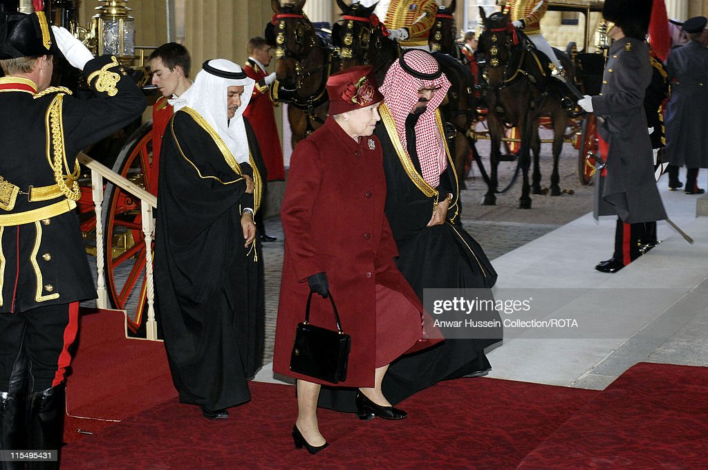 Queen Elizabeth ll and King Abdullah of Saudi Arabia arrive at Buckingham Palace following a ceremonial welcome on October 30, 2007 in London, England.