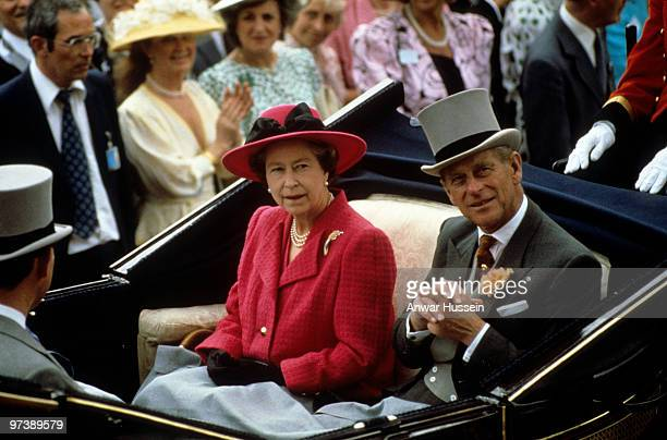 Queen Elizabeth ll and Prince Philip Duke of Edinburgh arrive at Royal Ascot in an open carriage at Royal Asoct on June 17 1988 in Ascot England