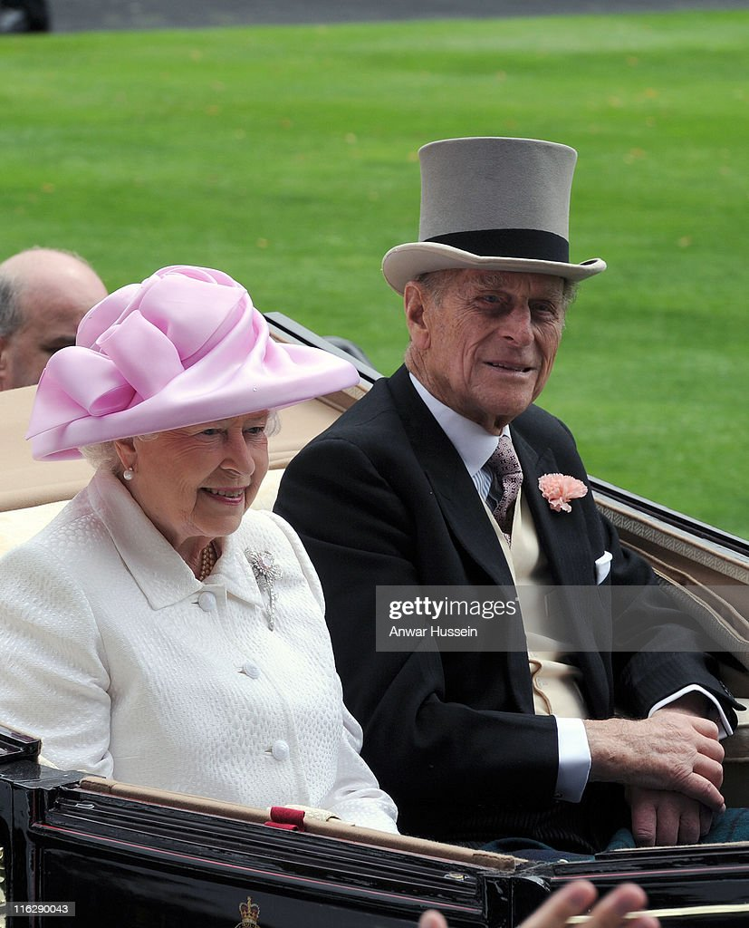 Queen Elizabeth ll and Prince Philip, Duke of Edinburgh arrive in an open carriage during day two of Royal Ascot at Ascot racecourse on June 15, 2011 in Ascot, England.