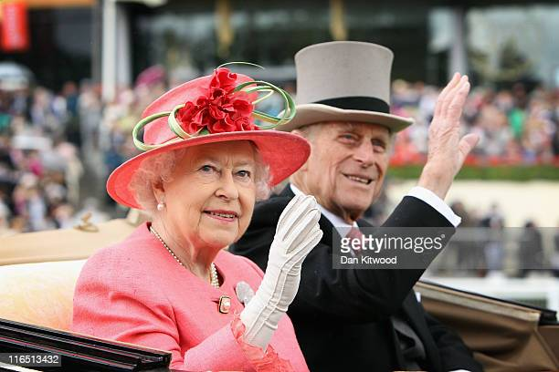 Queen Elizabeth ll and Prince Philip Duke of Edinburgh arrive in an open carriage on Ladies Day at Royal Ascot on June 16 2011 in Ascot England The...