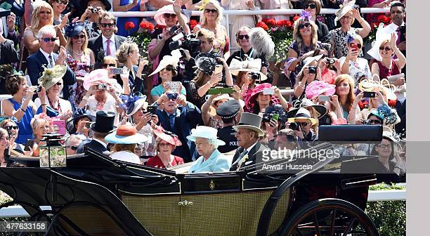 Queen Elizabeth ll and Prince Philip Duke of Edinburgh arrive in an open carriage to attend Ladies Day on day 3 of Royal Ascot on June 18 2015 in...