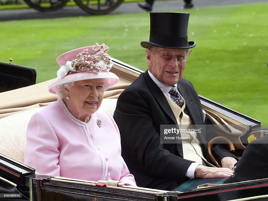 Queen Elizabeth ll and Prince Philip, Duke of Edinburgh arrive in an open carriage to attend Day 2 of Royal Ascot on June 15, 2016 in Ascot, England.