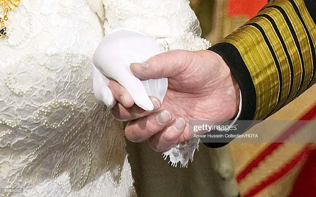 Queen Elizabeth ll and Prince Philip Duke of Edinburgh hold habds as they attend the State Opening of Parliament on December 3 2008 in London England