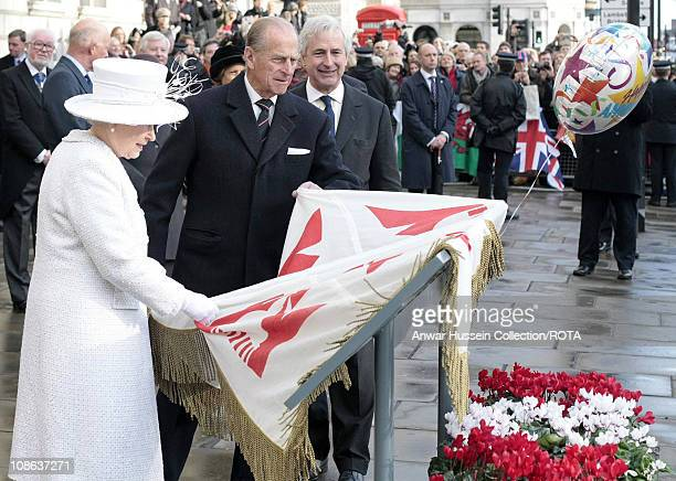 Queen Elizabeth ll and Prince Philip Duke of Edinburgh unveil the Jubilee Walkway panel on Parliament Square following a service to celebrate their...