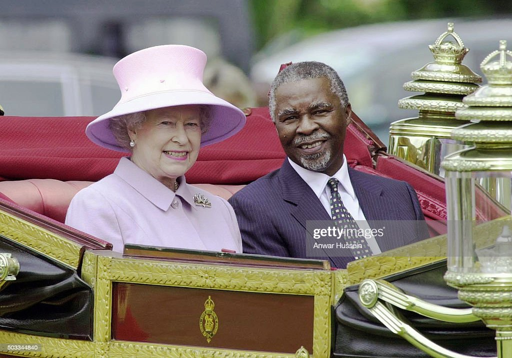 Queen Elizabeth ll and South African President <a gi-track='captionPersonalityLinkClicked' href=/galleries/search?phrase=Thabo+Mbeki&family=editorial&specificpeople=160910 ng-click='$event.stopPropagation()'>Thabo Mbeki</a> travel in an open carriage at the start of his State Visit to Britain on June 12, 2001 in Windsor, England.