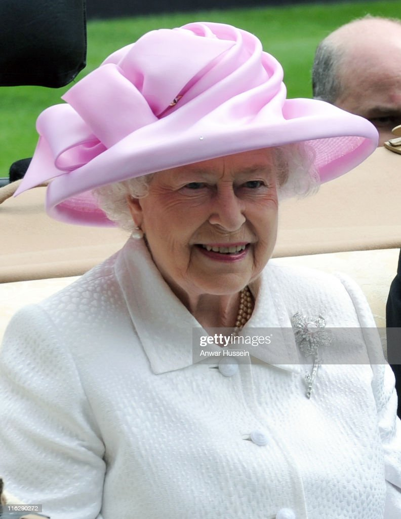 Queen Elizabeth ll arrives in an open carriage during day two of Royal Ascot at Ascot racecourse on June 15, 2011 in Ascot, England.