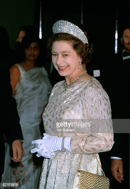 Queen Elizabeth Ll At A State Banquet Wearing An Evening Dress Designed By Fashion Designer Sir Hardy Amies With The Kokoshnick Tiara And Queen...