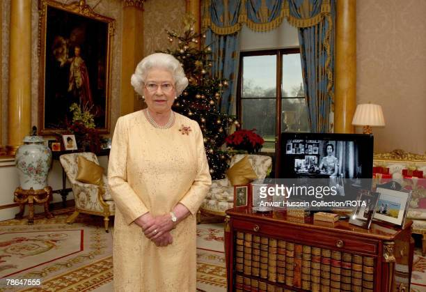 Queen Elizabeth ll delivers her Christmas speech in the 1844 Room at Buckingham Palace marking the 50th anniversary of her first televised Noel...