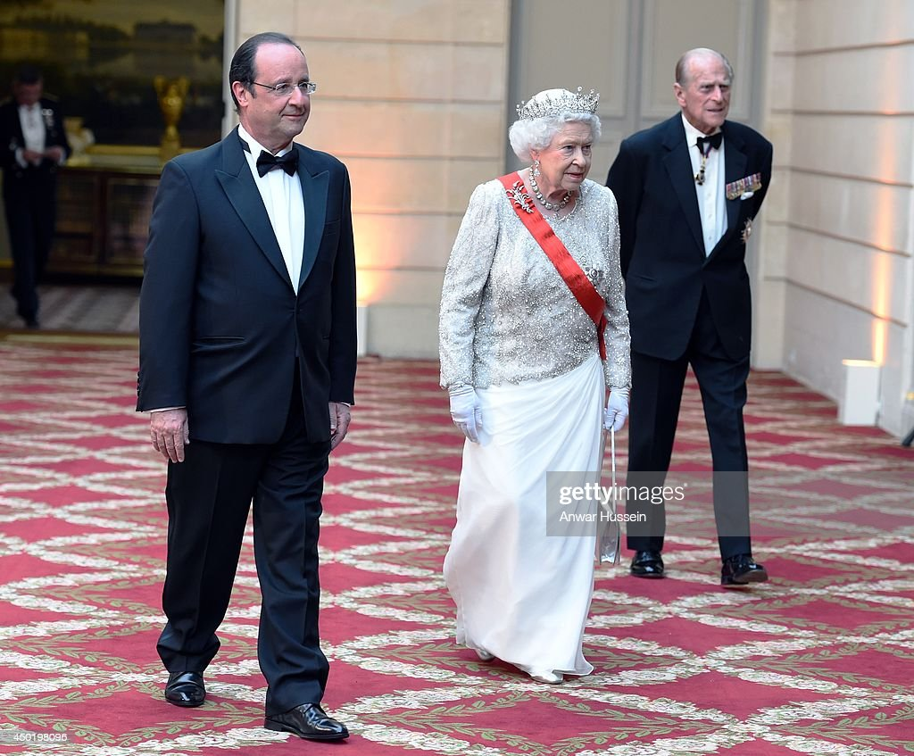 Queen Elizabeth ll, French President Francois Hollande and <a gi-track='captionPersonalityLinkClicked' href=/galleries/search?phrase=Prince+Philip&family=editorial&specificpeople=92394 ng-click='$event.stopPropagation()'>Prince Philip</a>, Duke of Edinburgh arrive for a State Banquet at the Elysee Palace on June 6, 2014 in Paris, France.