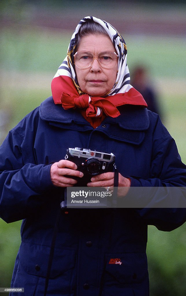 Queen Elizabeth ll holds her camera during the Royal Windsor Horse Show on May 01, circa1990 in Windsor, England.