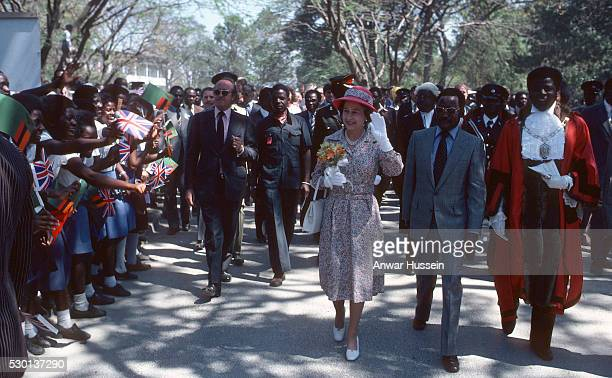 Queen Elizabeth ll is greeted by the public as she arrives in Lusaka on July 311979 in Lusaka Zambia