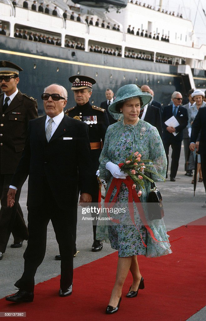 Queen Elizabeth ll is met by President <a gi-track='captionPersonalityLinkClicked' href=/galleries/search?phrase=Habib+Bourguiba&family=editorial&specificpeople=213571 ng-click='$event.stopPropagation()'>Habib Bourguiba</a> as she arrives in Tunis on the Royal Yacht Britannia on October 21, 1980 in Tunis, Tunisia.