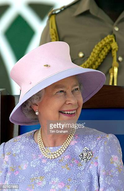 Queen Elizabeth Ll Looking Up And Smiling Whilst Watching A Cultural Presentation At The Civic Reception In Sam Sharpe Square The Queen Is Wearing A...