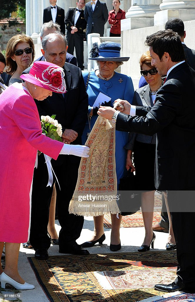 Queen Elizabeth ll looks at Turkish rugs and carpets during a visit to Kabatas school on the third day of a State Visit to Turkey on May 15, 2008 in Istanbul, Turkey.