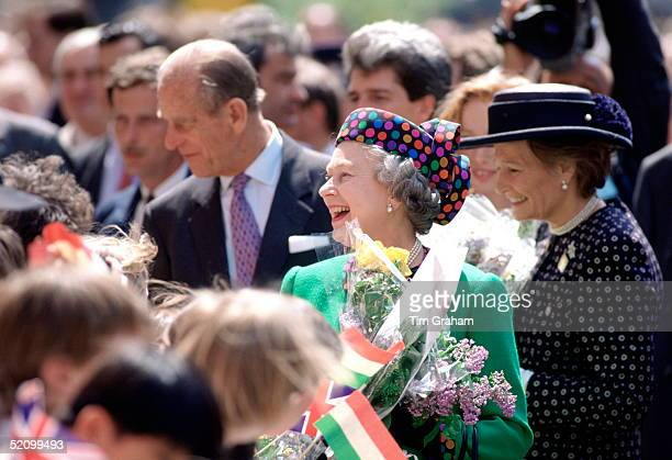 Queen Elizabeth Ll On Tour With Her Husband Prince Philip Laughing And Joking With Members Of The Crowd Who Have Gathered To Greet Her During A...