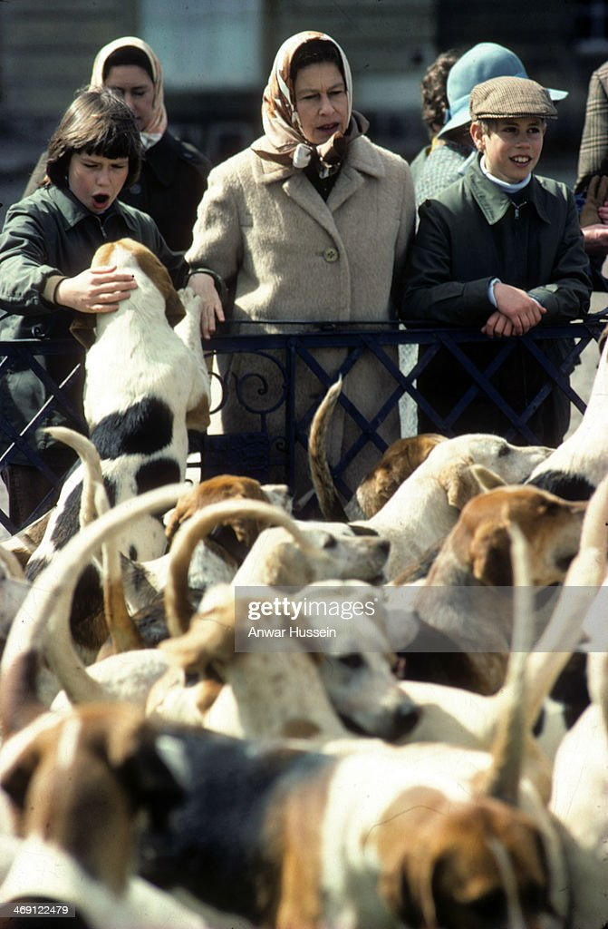 Queen Elizabeth ll, Prince Edward and Lady Sarah Armstrong-Jones look at hounds together as they attend Badminton Horse Trials on April 01, 1977 in Badminton, England.