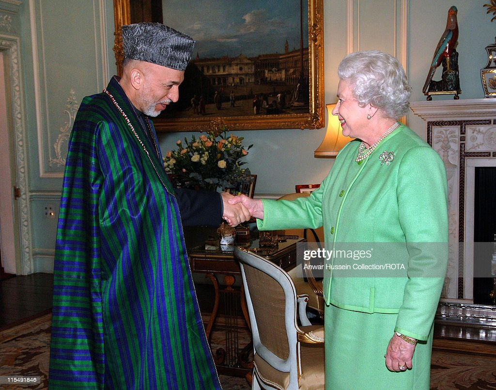 Queen Elizabeth ll receives the President of Afghanistan, <a gi-track='captionPersonalityLinkClicked' href=/galleries/search?phrase=Hamid+Karzai&family=editorial&specificpeople=121540 ng-click='$event.stopPropagation()'>Hamid Karzai</a>, in the Private Audience Room at Buckingham Palace on October 24, 2007 in London, England.