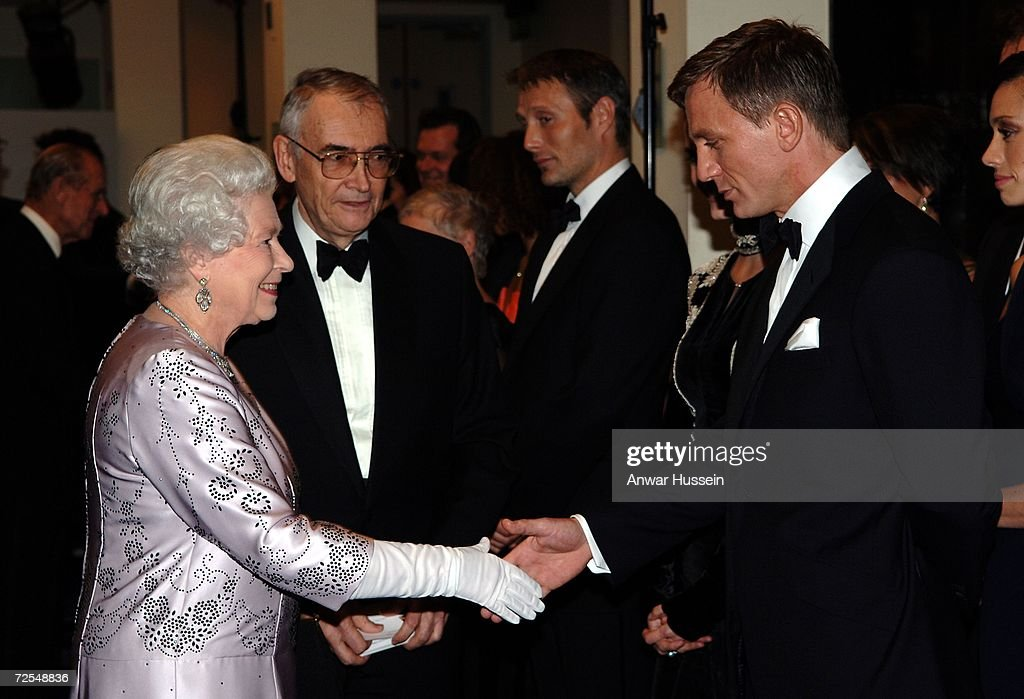 Queen Elizabeth ll shakes hands with Daniel Craig, the new James Bond, at the Royal Premiere for the 21st Bond film 'Casino Royale' at the Odeon Leicester Square on November 14, 2006 in London, England.