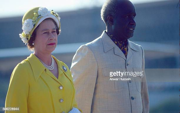 Queen Elizabeth ll stands with President Kenneth Kaunda as she arrives to attend the Commonwealth Heads of Government meeting on August 01 1979 in...