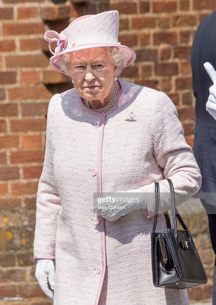 Queen Elizabeth ll visits The Royal Garrison Church at Knighton Down on May 26, 2016 in Lark Hill, England.