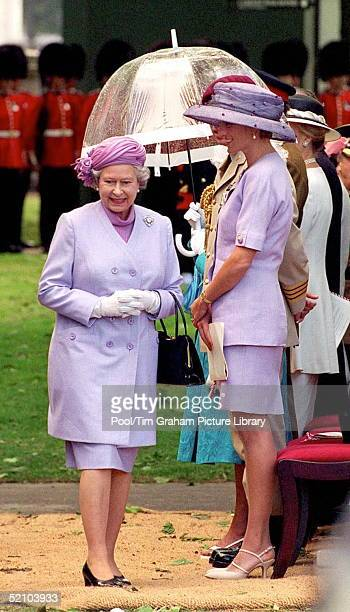 Queen Elizabeth Ll Walking Past Princess Diana At The Unveiling Of The Canada Memorial Foundation Monument In Green Park London Both The Queen And...