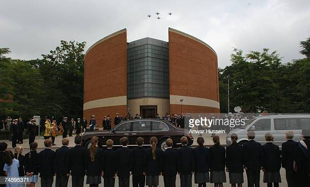 Queen Elizabeth ll watches a flypast as she arrives for a memorial service commemmorating 25 years since the Falklands conflict at the Falkland...