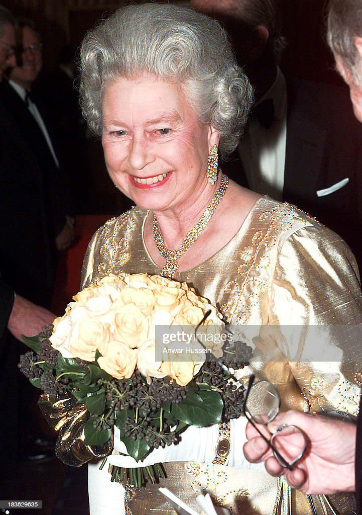 Queen Elizabeth ll wearing a gold dress for the occasion arrives at the Festival Hall for a Royal Gala to celebrate her Golden Wedding Anniversary on...